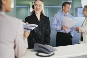 Receptionists often handle multiple tasks in a busy environment.