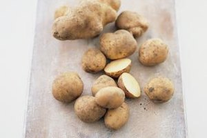Once you've cut a potato, the oxygen in the air interacts with its carbohydrates and darkens the flesh.