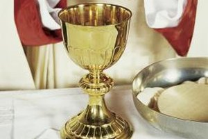 The priest will lead the blessing of the Eucharist.
