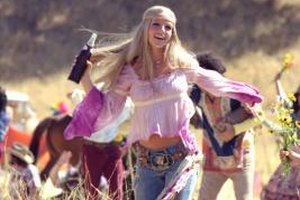Britney Spears stars in a Pepsi commercial dressed in vintage hippie-inspired clothing.