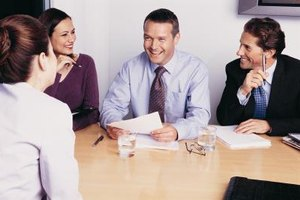 Make eye contact as you shake hands with each person on the interview panel.