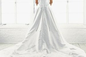 Many wedding-gown preservation companies will treat stains before preparing them for storage.