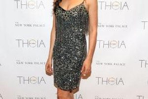 Erin Brady keeps her sequin slip dress simply styled with strappy nude heels.