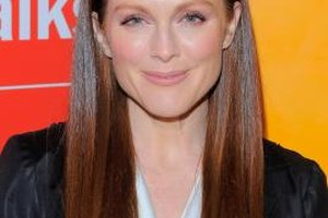Actress Julianne Moore softens her natural freckles with makeup.
