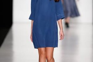 A model shows off a shift in electric blue on the runway during Fashion Week in Moscow in October 2013.