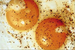 Serve fried and poached eggs sprinkled with salt and pepper.