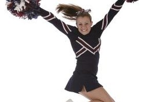 Dedicate scrapbook pages to your teen's interests, such as cheerleading.