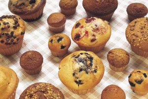 Muffins in various sizes usually have rounded, golden-brown tops.