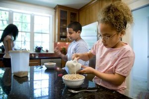 Whole-grain cereal with milk provides an assortment of vitamins and minerals your child needs.