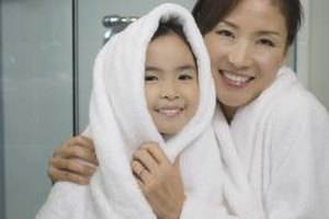 If you and your child are comfortable, taking a shower together can help you demonstrate and teach proper shower steps.