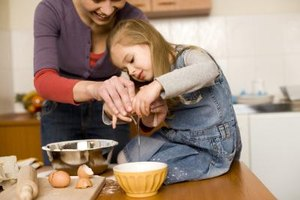 Preschoolers can learn while helping with household tasks.