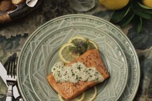 Encourage your kids to eat their salmon by topping it with a dill sauce or creamy dressing.