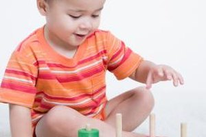 Toddlers learn to match and sort alike objects.