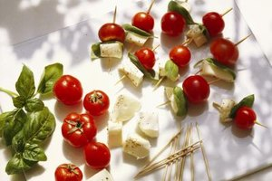 Skewer meats, vegetables and cheeses with toothpicks for a simple, yet elegant, appetizer.
