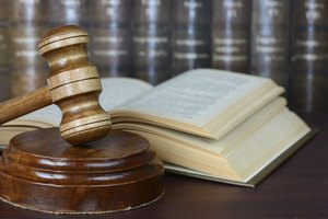 Close-up of legal gavel and law books.