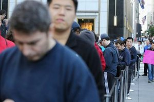 Cell phones have changed a lot, but people still line up to buy them.