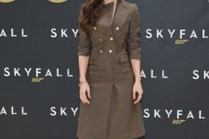 "Bernice Marlohe wears brown knee boots to the ""Skyfall"" cast photo call in New York City."