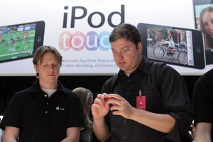 The iPod Touch automatically downloads the time over a Wi-Fi connection.