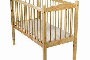 A mattress pad should fit tightly over the crib mattress.