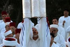 A Samaritan Priest raises the Torah, during Passover 2007, Mount Gerizim in the West Bank.