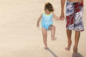 Marching, shuffling and walking through sand expand your tot's tactile experiences.