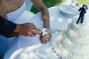 A thoughtful presentation makes cutting the cake a high point of the wedding reception.