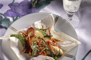 Chicken steamed in parchment paper makes a fun and unusual meal.