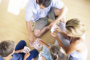 Playing games as a family helps kids learn cooperation and compromise.