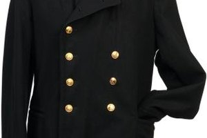 Gold buttons take a black jacket out of the dark and into the spotlight.