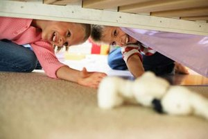 Under the bed is a common hiding spot.