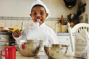 Your preschooler can help you to cook during a science activity.