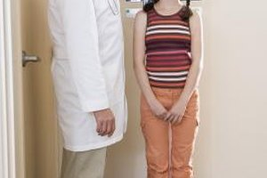The doctor takes an accurate measurement of your child's height.