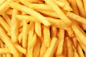 French fries are oil-blanched to make them light and crisp when they're fried.