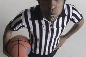 Basketball games are usually officiated by three referees.