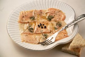 Flecks of dill from a lemony marinade add their distinctive flavor to any salmon dish.