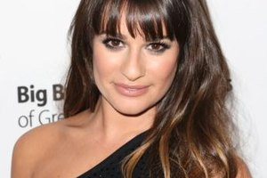 Lea Michele's sleek fringe accentuates her natural beauty.