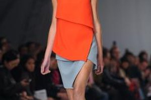 Pair a bold color like tangerine with gray to balance your outfit.