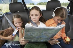 Music, food or reading material can all help keep kids quiet in the car.