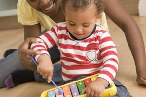 Encourage your toddler's love of music through instrument instruction.