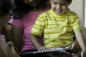 Reading to your preschooler can help to build his literacy skills.