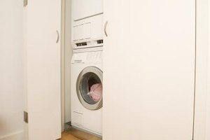 Laundry rooms often hide behind accordion closet doors.