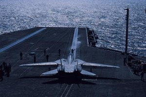 Navy fighter pilots must be able to operate off an aircraft carrier.