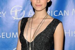 Emmy Rossum wears delicate silver chains with a black sequined top at the American Museum of Natural History's 2010 Museum Dance.