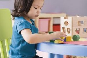Toys can help you teach English language skills.