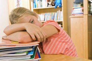 A stack of homework is overwhelming for some children.