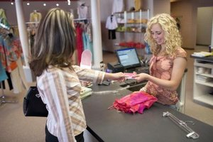 Retail sales associates spend the day interacting with customers to make a sale.