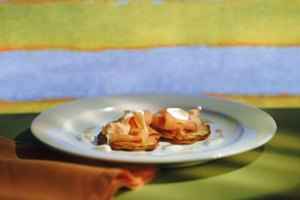 Blini topped with smoked salmon and chopped egg is an easy, elegant appetizer to create.