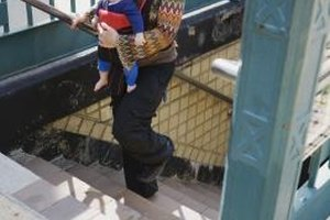Carry your baby in a sling while riding rapid transit systems.