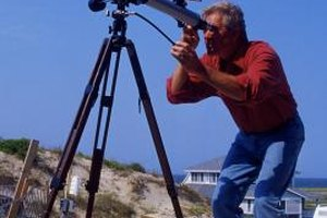 Astronomers use telescopes and other observational tools to study the skies.