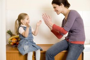 Clapping while singing can help your child practice coordination, rhythm and concentration.